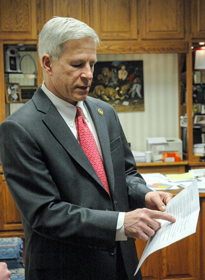 State Sen. Rob Schaaf points to evidence in support of his opposition to the database bill in his office at the Missouri State Capitol. He said the bill interfered with the right to medical privacy. Jiselle Macalaguin/KOMU/ Flickr