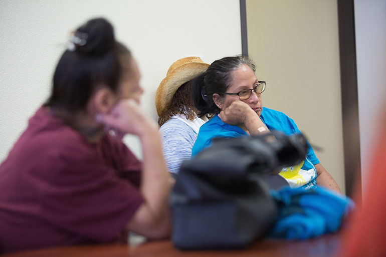 Laura Castillo, right, learns about treatment of her hepatitus C infection from Dr. Katie Moizeau Thursday, March 3, 2016 at a weekly clinic in Sacramento.