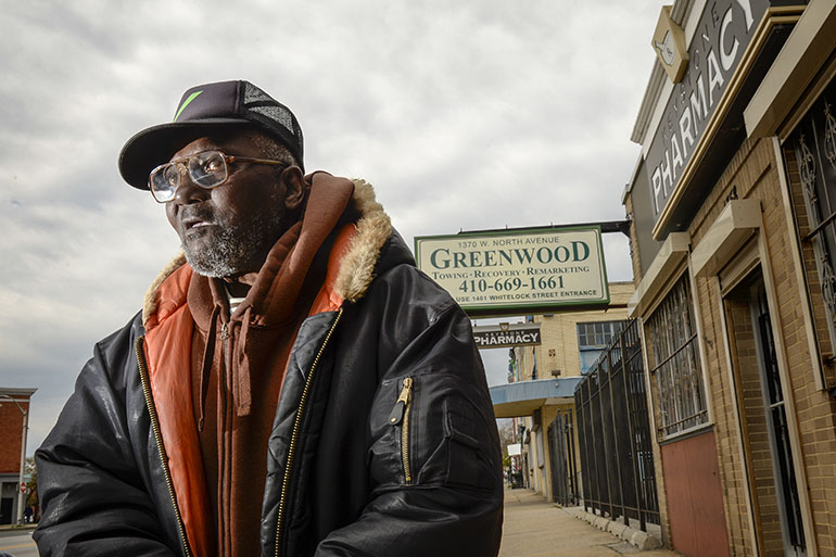 Ellis Basnight, 71, says he relies on the independent Keystone Pharmacy, which is a 15-minute walk from his house. Keystone's been in the neighborhood for decades, and was one of the stores looted in last spring's protests. (Doug Kapustin for KHN)