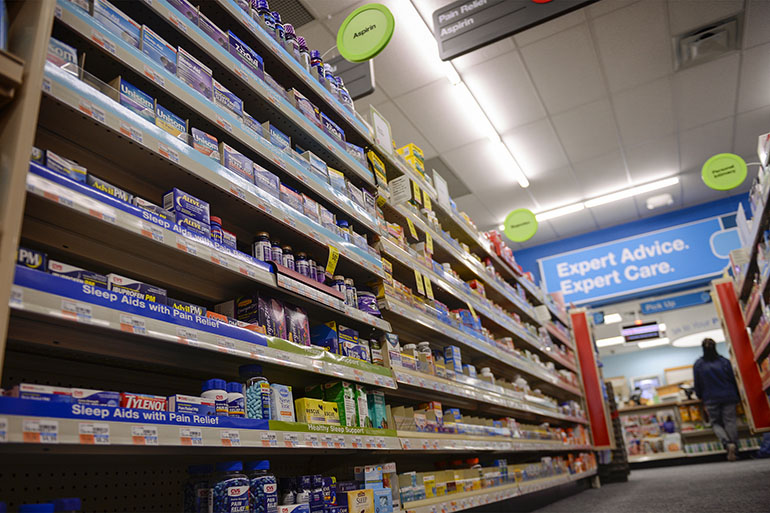 The new CVS contains several aisles of over-the-counter medications, a contrast to the much smaller Keystone. As a major national corporation, CVS can offer a wider array of goods than can its independent peers. (Doug Kapustin for KHN)
