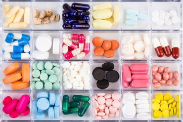 Various medicine pills and capsules in plastic container