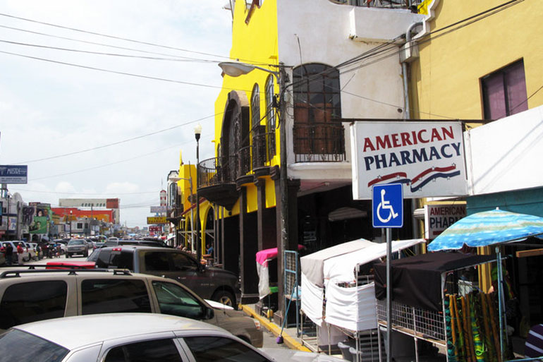 Pharmacies that line the main street of Nuevo Progreso, Mexico, sell many medicines over the counter that would require a prescription in the U.S. That's made the stores popular with visitors from nearby Texas. (John Burnett/NPR)