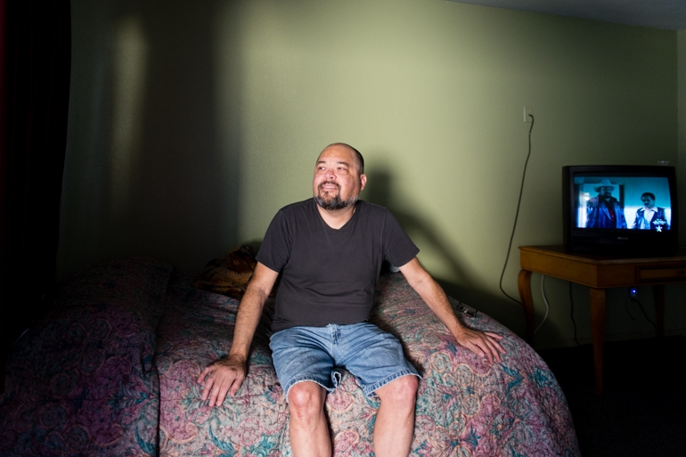 Elvin Quiñones, 55, in his room at the Coral Motel in Buena Park, Calif., on Friday, February 12, 2016. After gallbladder surgery, Quiñones didn't have anywhere to recover and ended up at the motel used by the Illumination Foundation Recuperative Care . (Heidi de Marco/KHN)