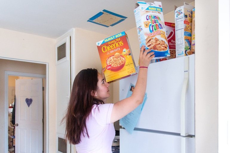 Sandy Roman, Benito Salgado's wife, said they keep extra cereal around just in case they need it if disaster strikes. Only 38 percent of Latino households reported having a disaster plan, the lowest for any ethnic or racial group in the county. (Heidi de Marco/KHN)