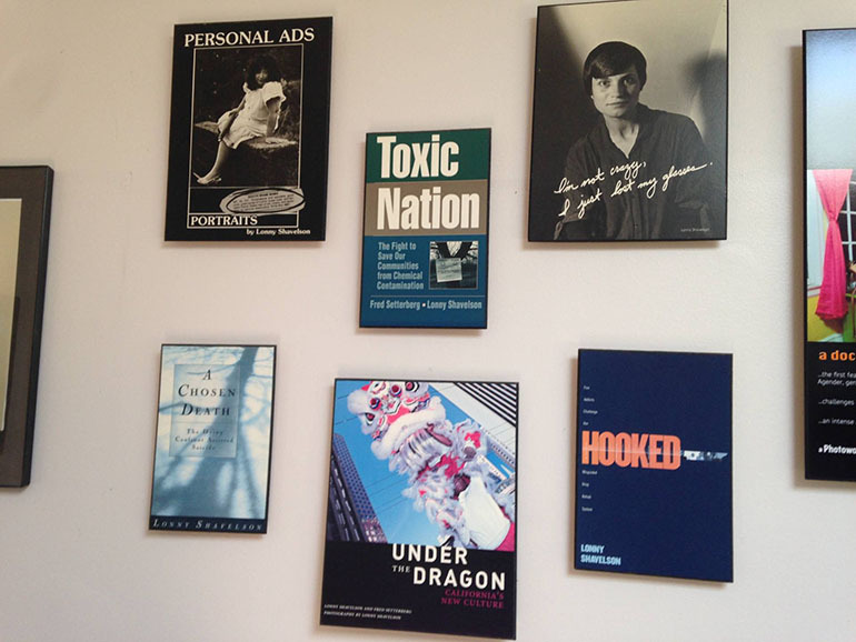 The wall of Lonny Shavelson's office, lined with covers of the books he has written. (Lisa Aliferis/KQED)