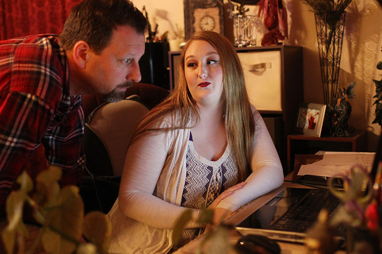 Shariah Vroman-Nagy and her father, Tom Nagy, at their home in Redding, Calif. (Andreas Fuhrmann/KQED)