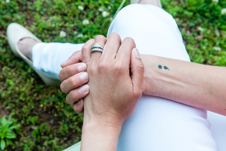 Powell has a semicolon tattoo on her right wrist. The tattoo refers to Project Semicolon, a nonprofit that aims to provide hope for those struggling with mental illness. (Heidi de Marco/KHN)