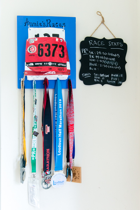 Competition medals and running stats hang in Annie Powell's house. Powell says fitness and working as a personal trainer contributed to overcoming her depression after giving birth to the twins. (Heidi de Marco/KHN)