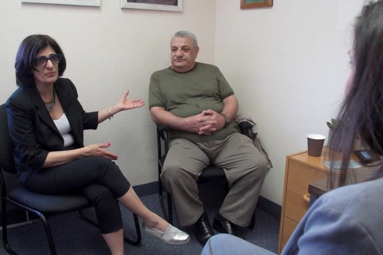 Interpreter Afaf Pickering at Lake Shore Clinic in Buffalo, N.Y. helps Kurd Bllnd during one of his therapy sessions. (Credit: PBS NewsHour)