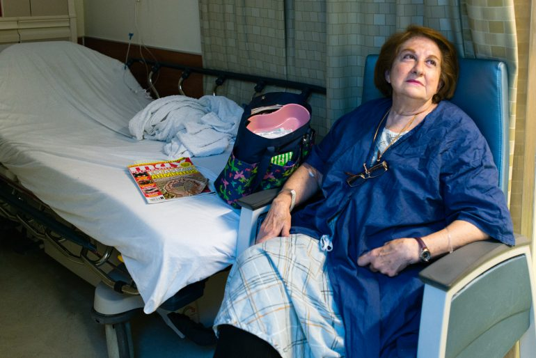 After being seen in the emergency room, Castellanos waits for a hospital bed for further testing. (Heidi de Marco/KHN)