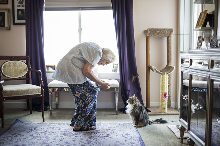 "Kathy Baron with Munchkin. Baron was left disabled by breast cancer and nerve pain. InnovAge has made it possible for her to stay in her home. ""I would rather be dead than go into a nursing home,"" she said. (Nick Cote for The New York Times and Kaiser Health News)"