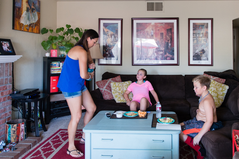 Jamie Hancock, 38, serves lunch to her children Blythe, 9, and Andrew, 7, on June 30, 2016. Hancock said she lost the cognitive ability to do certain tasks which made it difficult to keep her full-time, office job. (Heidi de Marco/KHN)