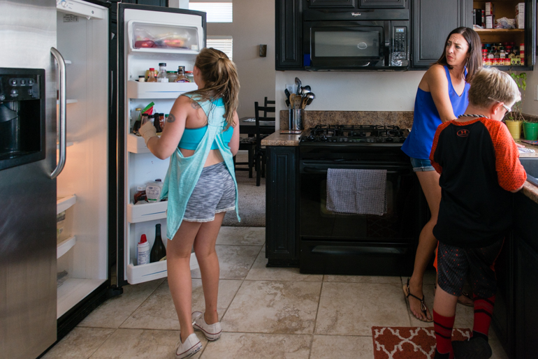 Jamie Hancock, 38, and her children Blythe, 9, and Andrew, 7, get ready for a shopping trip to the grocery store on June 30, 2016. Hancock said her stroke made her forgetful, so Blythe has to help her keep track of things around the house. (Heidi de Marco/KHN)