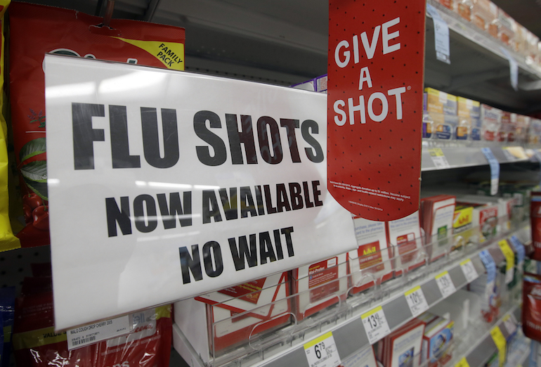 the ads say  u2018get your flu shot today  u2019 but it may be wiser