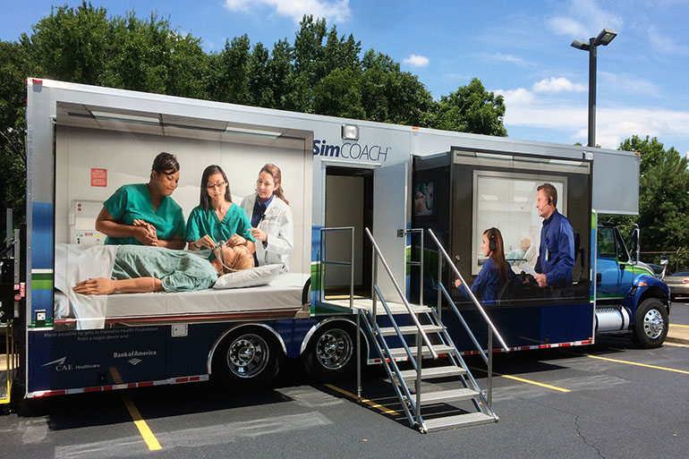 The University of South Carolina School of Medicine takes this SimCOACH -- outfitted with two simulated hospital delivery rooms -- throughout the state to train health care providers in a variety of procedures. Among the topics: the insertion and removal of contraceptive implants and IUDs.