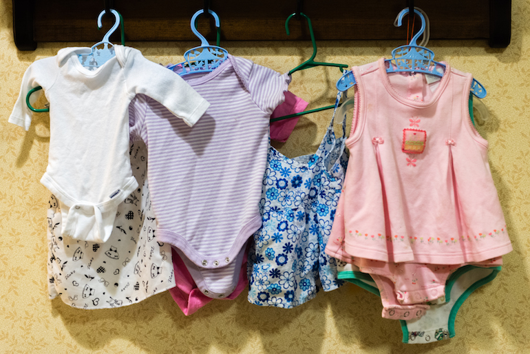 Baby clothes hang on the wall of the nursery area at Sunrise Senior Living in Beverly Hills, California, on August 2, 2016. The nursing home has dedicated a section of the facility for residents participating in doll therapy. (Heidi de Marco/KHN)
