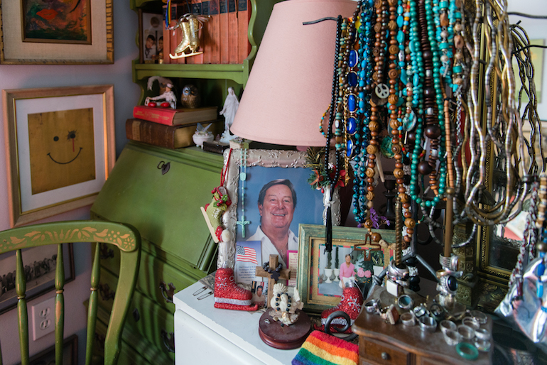 A photo of Dehag's partner sits on the dresser in his bedroom. Dehag moved into one of the apartments shortly after his partner passed away. (Heidi de Marco/KHN)