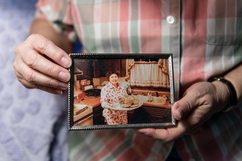 Marquardt holds an old photograph of herself of when she was married. Marquardt, a former truck driver who has high blood pressure and kidney disease, came out after raising three children. (Heidi de Marco/KHN)