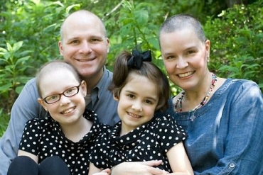 Georgia Moore, front left, was diagnosed with leukemia and because she was undergoing chemotherapy that impacted her immune system, she had to stay home from her small, private school in 2010, when this photo was taken. Her parents, Trevor and Courtney Moore, had to work to make sure that her younger sister, Ivy, didn't bring home germs that could endanger Georgia. (Courtesy of the Moore family)