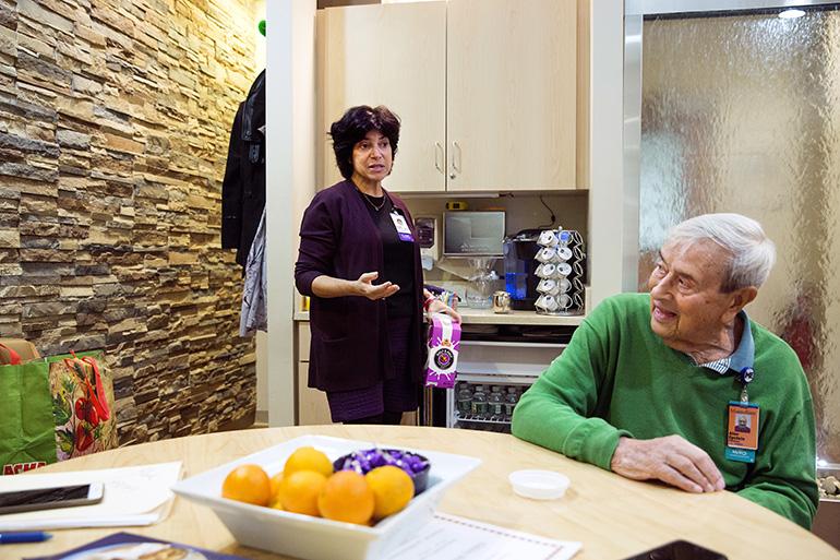 Randi Kaplan and Epstein talk in the caregiver support center at Montefiore Medical Center. (Ben Sklar for KHN)