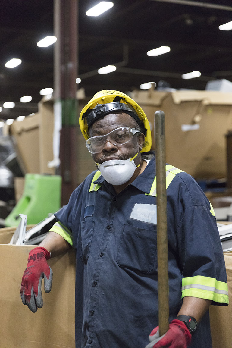 Henderson works at Recycle Force in Indianapolis, Indiana (Philip Scott Andrews/For KHN)
