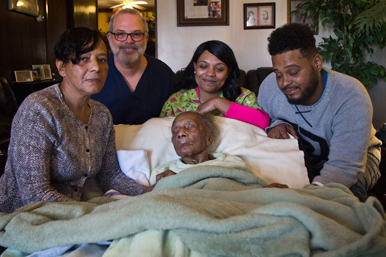 Bobo with her mother and home health nurse Dave Wilson; her son David's fiancee, Angel; and David. (Kimberly Paynter/WHYY)