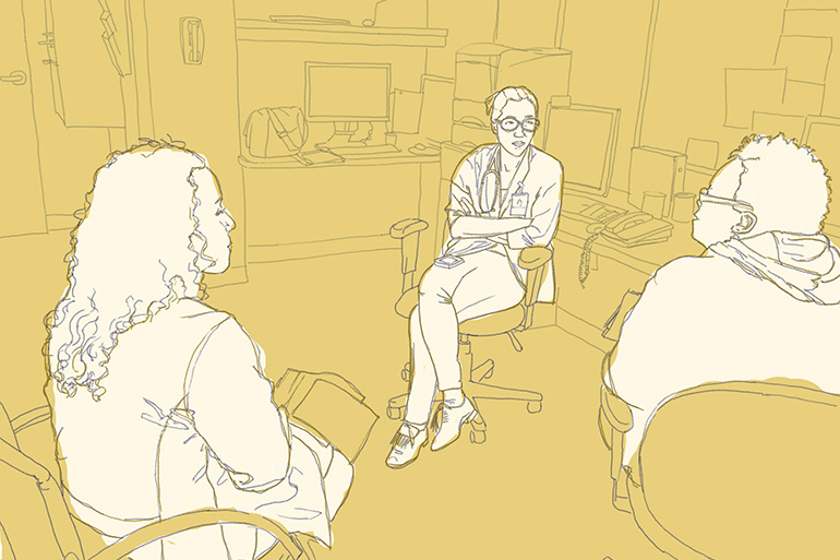Drs. Lisa Puglisi and Emily Wang talk with a community health worker about the patients they're about to see at a clinic for ex-offenders in New Haven, Conn. (Rae Ellen Bichell/NPR)
