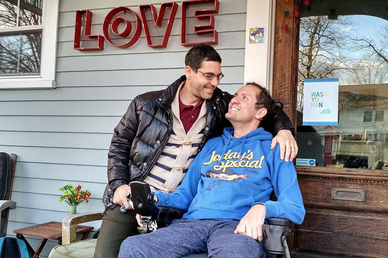 Adox, right, and his husband Danni Michaeli at their home in South Orange, N.J., in fall of 2014. Adox was diagnosed with ALS at age 42 and became almost totally paralyzed within six months. He died last May.