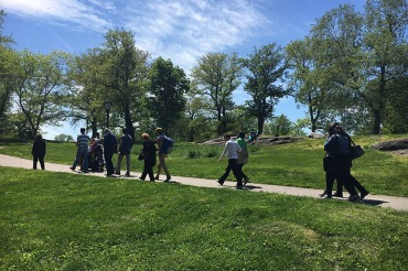 Adox, with family and friends, taking one last walk in Central Park together in May. (Karen Shakerdge/WXXI)