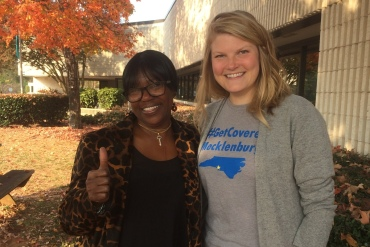 Darlene Hawes (left) and her enrollment counselor, Julieanne Taylor, outside the Mecklenburg County Health Department in Charlotte, N.C. (Michael Tomsic/WFAE)
