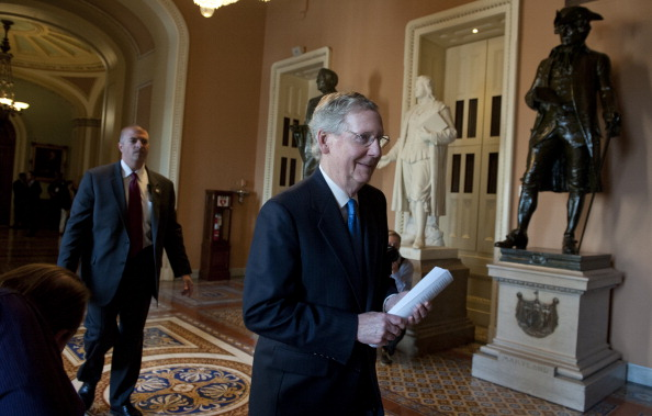 Senate Minority Leader Mitch McConnell, R-KY., heads to his office in the U. S. Capitol on September 30, 2013. The House of Representatives passed a continuing resolution with language to defund U.S. President Barack Obama's national health care plan (Obamacare) two days ago. (Douglas Graham/CQ Roll Call)