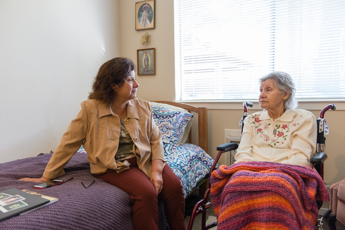 Barbara Marquez visits her mother Florence Marquez at her nursing home on Friday, December 16, 2016. Barbara was her mother's primary caregiver until the family decided to put their mother in a 24-hour care facility. (Heidi de Marco/KHN)