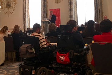 A Marathon Pharmaceutical executive speaks at the Parent Project Muscular Dystrophy advocacy conference. (Sarah Jane Tribble/KHN)
