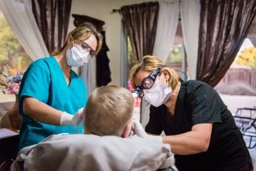 Dental hygienist Gita Aminloo cleans a patient's teeth.