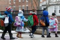 Elementary school students walk out of Saltonstall School in Salem, Massachusetts