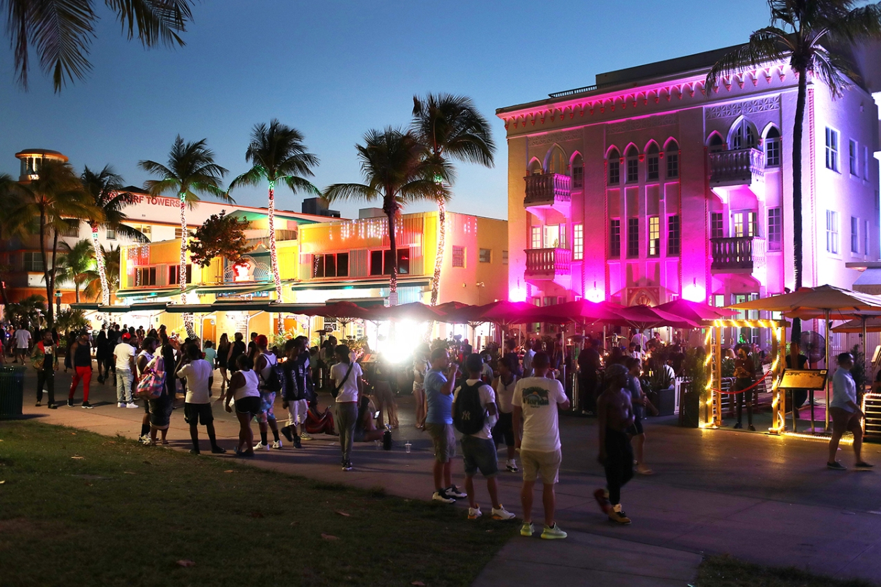People walk along Ocean Drive on March 18, 2021 in Miami Beach, Florida
