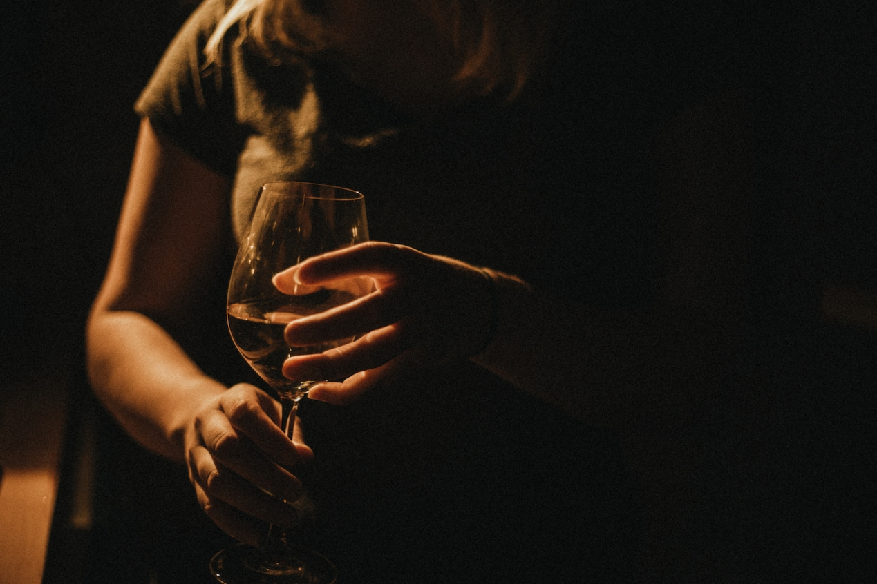 Woman drinks wine at home