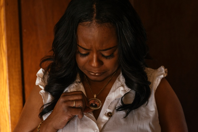 Rafiah Maxie holds a locket containing a photo of her son, Jamal Clay
